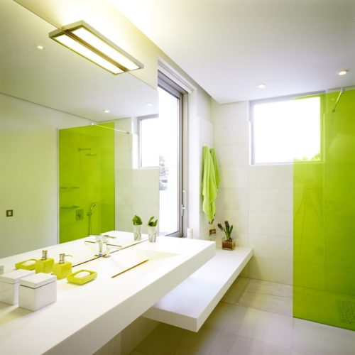 Favorite-Apartment-Bathroom-Ideas-with-White-Ceramic-Flooring-and-Modern-Vanity-Combined-with-Natural-Green-Glass-Shower-Designed-Luxurious-Bathroom-Interior